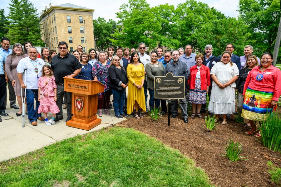 Members of the Ho-Chunk Nation are pictured during a heritage marker dedication ceremony for the Our Shared Future plaque on Bascom Hill at the University of Wisconsin-Madison on June 18, 2019